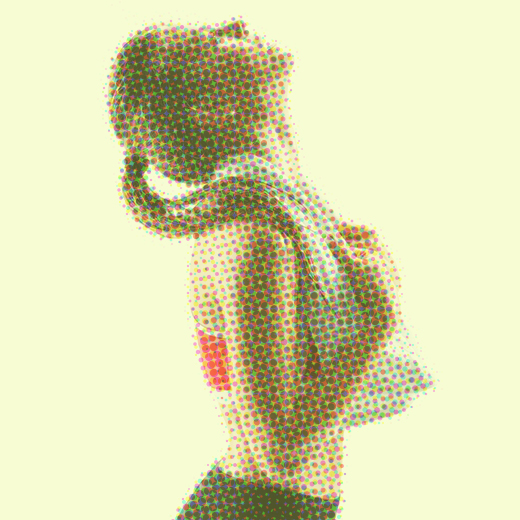 woman in workout gear looking toward the ceiling with towel around her shoulders