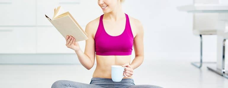 woman reading fitness books